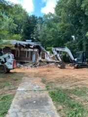 House Demolition and white excavator