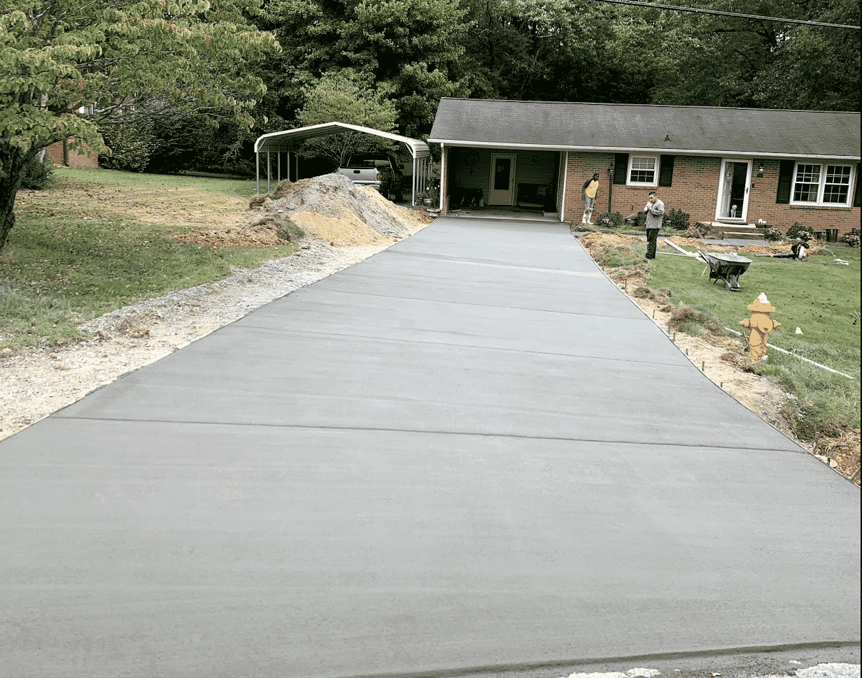 Concrete Driveway and Brick Ranch House