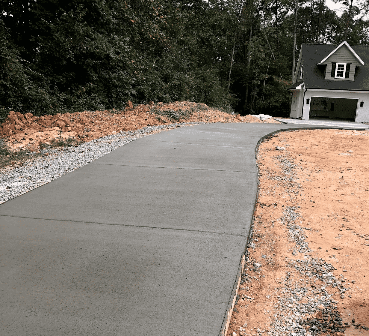 Concrete Driveway and grey house