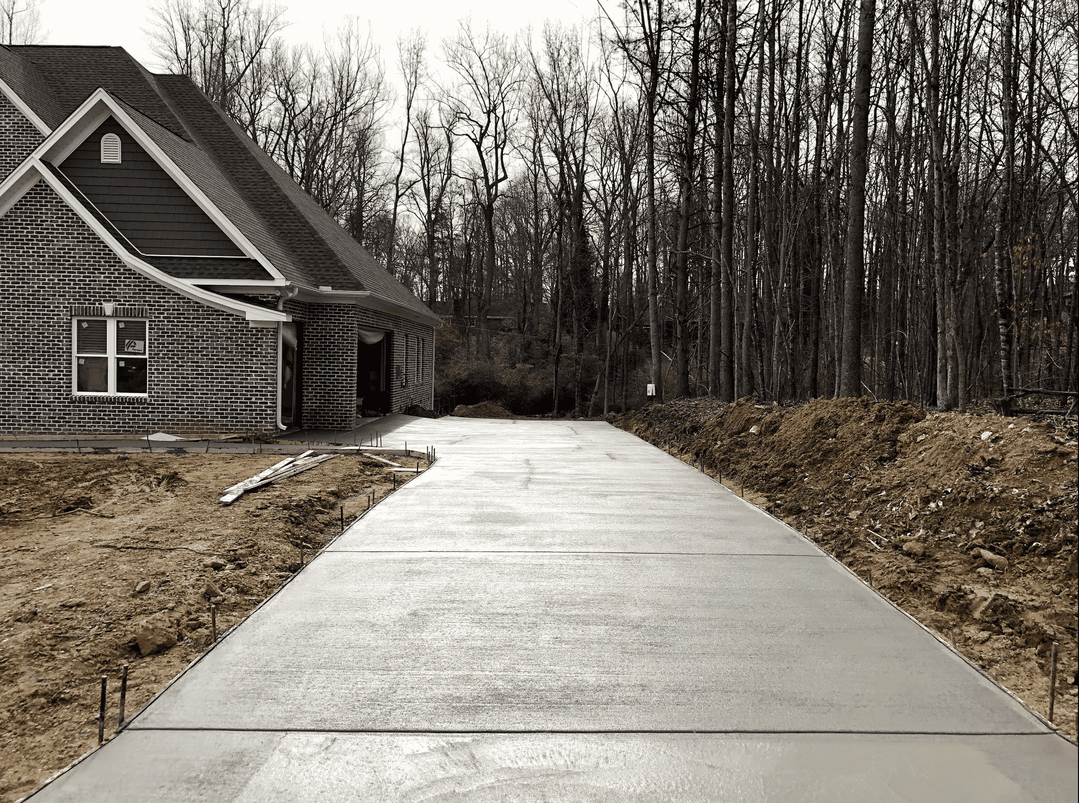 Concrete Driveway and Red Brick House